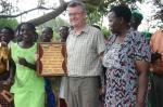 Chairman receiving plaque